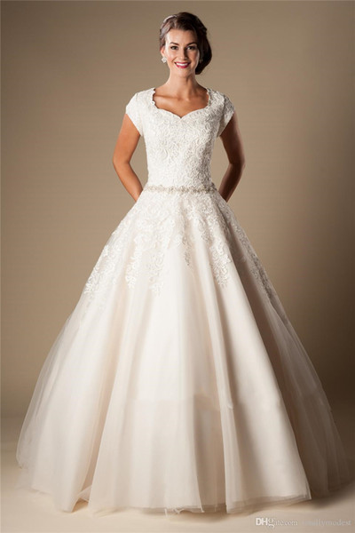 best selling Ivory Lace Tulle Ball Gown Modest Wedding Dresses 2020 Cap Sleeves Short Sleeves Princess Bridal Gowns Beaded Belt Bridal Gowns Button Back