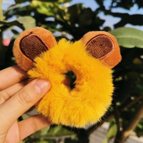Bären Sie Ohren mit gelben Haarkreisen