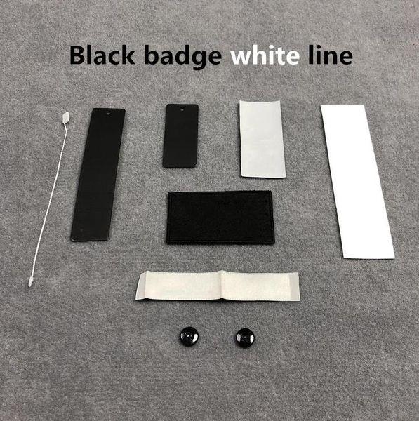 Línea blanca de insignia negra