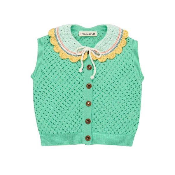 Grünes Strick-T-Shirt.