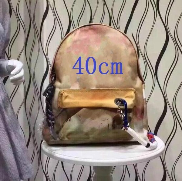 top popular Fashion graffiti splicing sports outdoor backpack large capacity camouflage schoolbag special for travelling locomotive 2021
