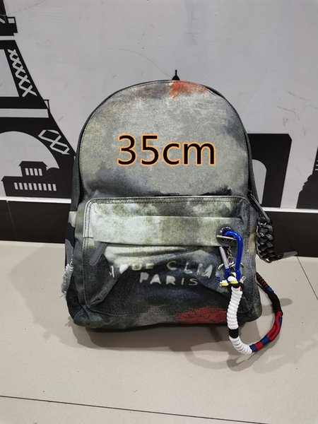 top popular Classic graffiti sports leisure backpack men's and women's canvas camouflage splicing handbag large capacity schoolbag 35cm 2021