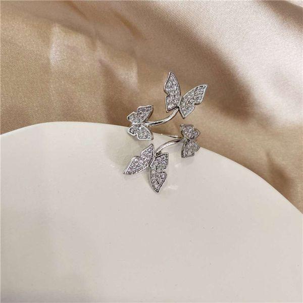 Quattro anelli di apertura della farfalla