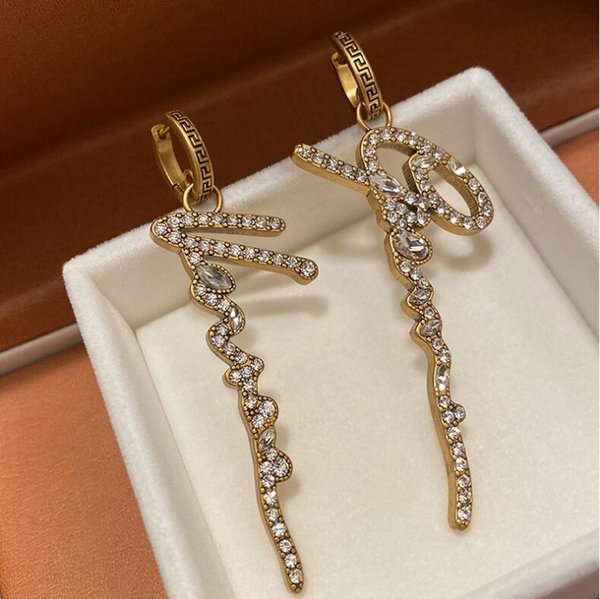 top popular Retro letters Dangle & Chandelier exaggerated brass back pattern crystal star same queen rhinestone metal earrings high quality fast delivery 2021