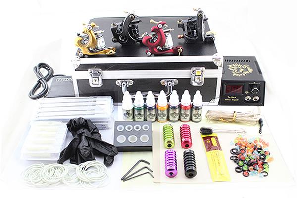 la dernière mode des kits de pistolets de tatouage professionnel complet 4 mitrailleuse de tatouage noir alimentation 7color encres grip 50 aiguilles pédale en alliage boxl