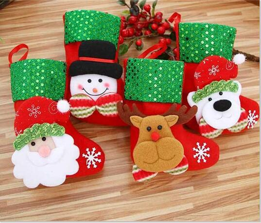 top popular 2000pcs Christmas Stocking Sequin Socks Gifts Sacks Candy Bags Cartoon Stockings Christmas Tree Decor Santa Claus Snowman Deer Bear 2019