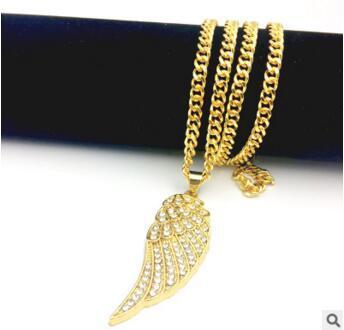 Alas de ángel de oro de 14 K Collar de diamante labial alas unilaterales Colgante de hip hop estilo americano europeo