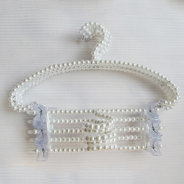 Il gancio in rilievo della perla di trasporto 200pcs / lot libero può antiscivolo che appende i vestiti delle donne ed è molto bello