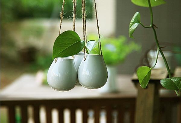 Keramische hängende Pflanzer der Form des weißen Eies 2pcs / set, die keramische Topfhauptdekoration oder Housewarminggeschenkgartendekor-Grüngeschenke hängen