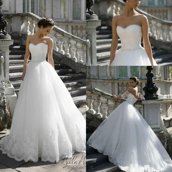 Bolas de novia románticas sin mangas de los vestidos de novia 2018 apliques de encaje para el estilo occidental capilla de la ilusión bolas de baile vestidos de novia