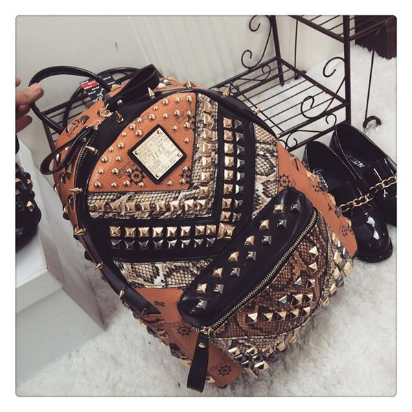 best selling 2015 new fashion women and men backpack JTXS PU rivet serpentine patchwork backpack punk backpack leisure bags party bags two colors 637-2