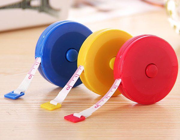 top popular Candy color 1.5M mini portable tape measure keychain Sewing Tailor Retractable Ruler Tape Free Shipping 2021