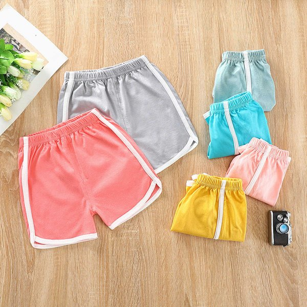 top popular Summer Children's Shorts 21 New Cotton Sports Beach Strap Solid Color Pants for Children 2021