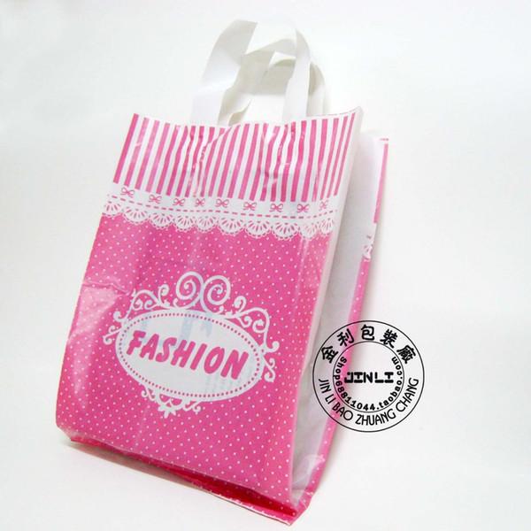 Livraison Gratuite 50 pcs / lot 25 * 35 Bas Haute Qualité Couleur Rose Sac En Plastique Sac Avec Poignée Vêtements Sacs pour les filles