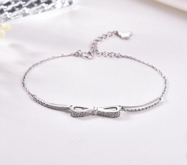 The new 100% S925 sterling silver bow is set with a white diamond bracelet