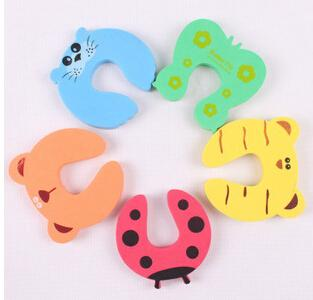 top popular Cute Baby Door Stopper Safety Finger Pinch Guard Protector Baby safety gate card Animal model 2019
