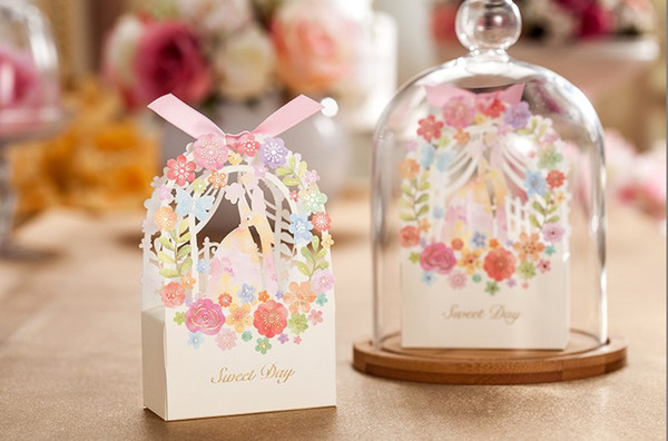 2016 New Spring Gift Favours Continental white Laser Cut Hollow Flora Wedding Favor Boxes High-Grade Paper Favor Boxes With Bow