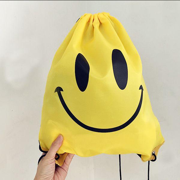 top popular 40pcs Cute Emoji Drawstring Bags for Women Mens Children Cartoon Unisex Emoji Backpacks Fashion Smile Printed Student bags EMJ025 2019