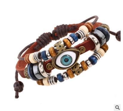 Braccialetti di fascino del branello di un occhio di cuoio nero / del Brown per i monili femminili maschii del polsino del polsino intrecciato regolabile delle donne