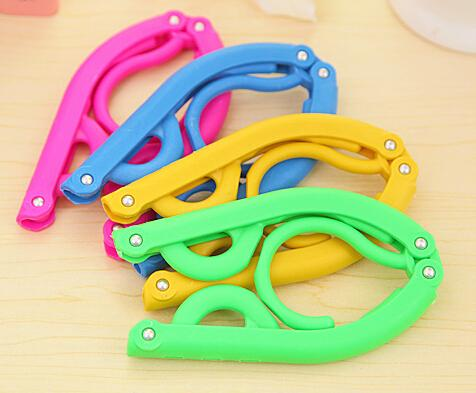 Home essential travel portable folding hanger plastic hanger magic
