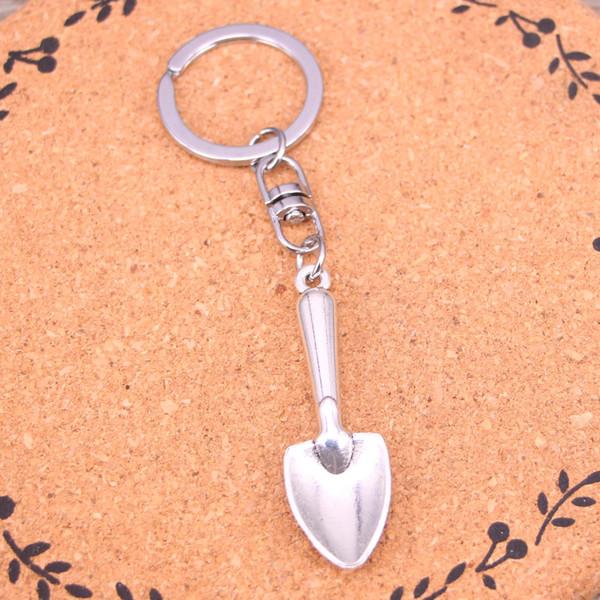 Nouvelle arrivée nouveauté souvenir pelle en métal bêche truelle jardinage porte-clés cadeaux créatifs Apple porte-clés porte-clés bibelots porte-clés de voiture