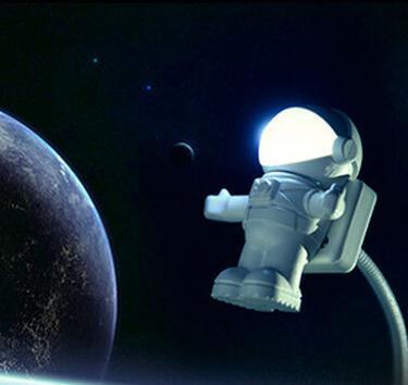 Il nuovo astronauta dell'astronauta del fumetto del partito della luce notturna degli astronauti creativi ha condotto l'illuminazione della lampada per il trasporto bianco di goccia del regalo di fonte di alimentazione portatile del computer