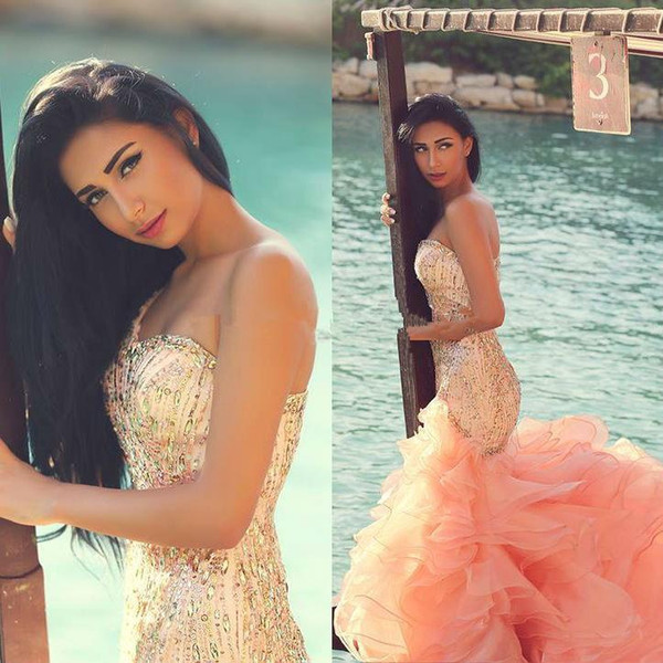 2016 Newest Luxury Crystal Peach Prom Dresses Sweetheart Beaded Slim Fitted Mermaid Arabic Evening Gowns Ruffled Organza Court Train