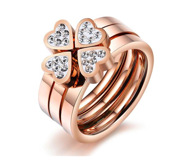 Mélange lot de bijoux coréens bonheur Clover tempérament rose or diamant triple amour titane acier anneau femelle