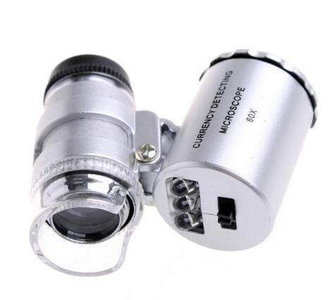 top popular 2 in 1 60X mini Pocket Magnifier Microscope Loupe with LED light + UV Currency detector with LR1130 button battery 2019