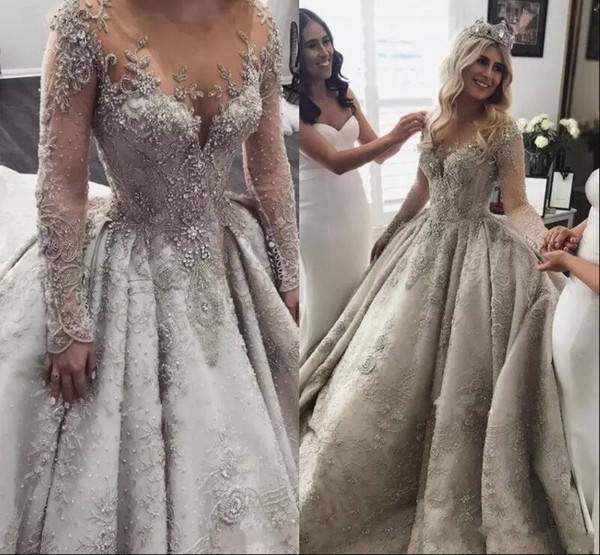 Luxury Arabic Silver Long Sleeves Wedding Dresses 2019 New Elegant Sheer Neck Illusion Back Lace Beaded Crystals Bridal Gowns Custom Made