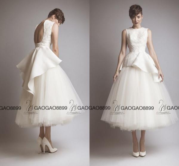 Gorgeous Vintage Tea length Summer Beach Wedding Dresses Ashi Studio Middle East Saudi Arabic Backless Peplum Wedding Gown