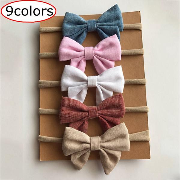 Migliore qualità 9 colori cotone fatti a mano bambini neonati arco fasce di nylon morbido nylon copricapo nylon fascia elastica fascia testa libera la nave