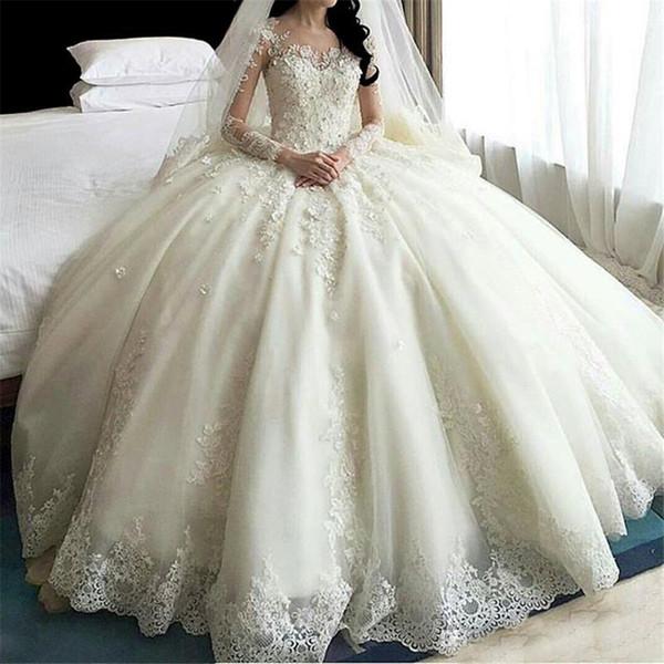 top popular 2019 Long Sleeve Muslim Wedding Dress Arab Wedding Gowns See Through Back Hot Sale Dubai Luxury Crystal Flowers Ball Gown Wedding Dresses 2021