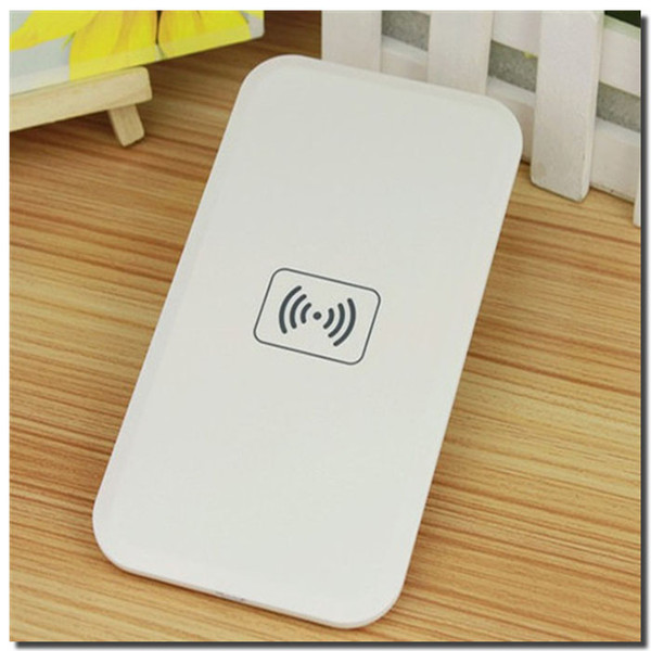 white wireless charger pad