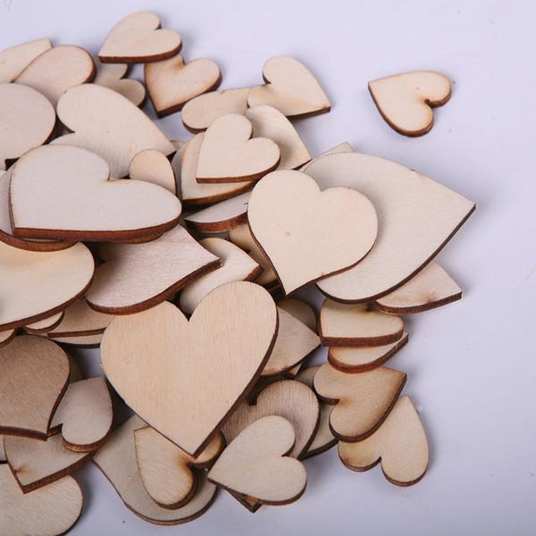 100 pcs / sac blanc non fini en bois coeur artisanat fournitures coupe laser rustique bois anneaux de mariage ornements
