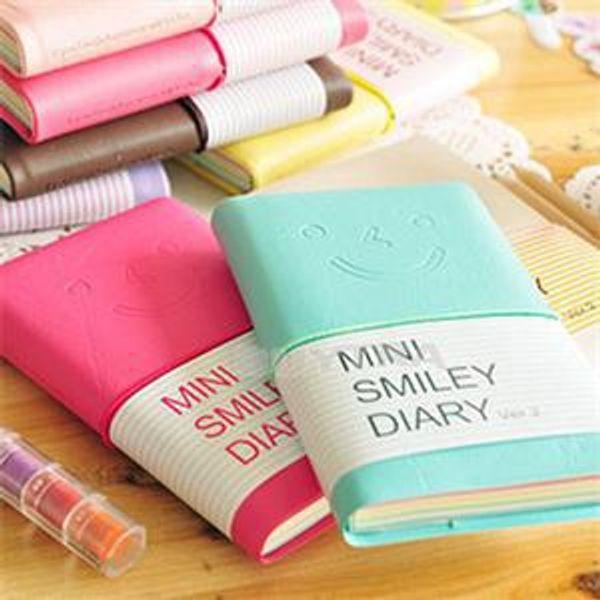 Al por mayor-6 colores Mini Smiley Diary Notebook Memo Book notas de cuero de papelería de bolsillo 100 páginas