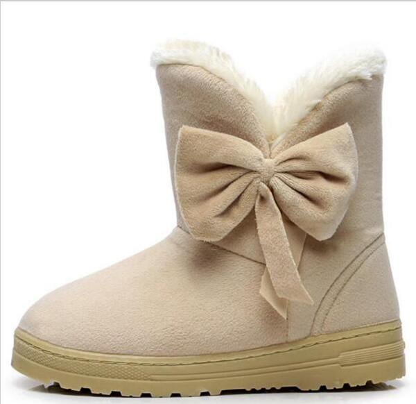 Compre Nuevas Mujeres Calientes De La Venta Botas De Nieve Solid Bowtie Slip On Mujeres Lindas Botas Botas Punta Redonda Plana Con Zapatos De Invierno