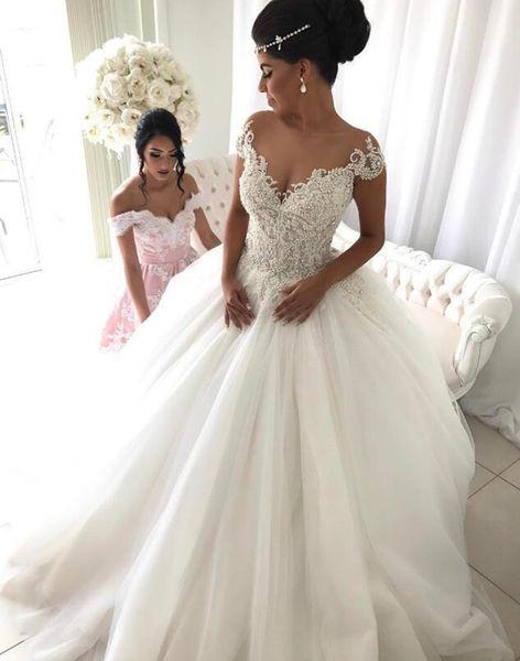 Moda brillante perlas de cristal princesa nuevo vestido de bola vestido de novia de manga corta por encargo de encaje de novia de tul de alta calidad transparente