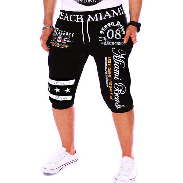 Оптовая торговля-PKORLI Марка мужчины спортивные шорты пляжная одежда повседневная лето печатных бегунов мужские сексуальные шорты для бега человек дизайнер короткие брюки