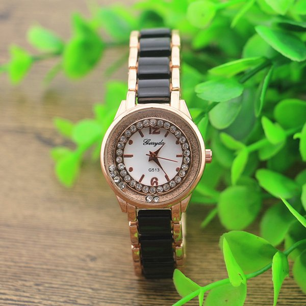 Free shipping!Black copy ceramic metal band,gold plating round case,crystal deco under glass,gerryda fashion woman lady quartz ceramic watch