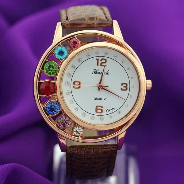 Free shipping!PVC leather band,gold plate round case,7 big crystal deco case,quartz movement,Gerryda fashion woman lady quartz watches,698