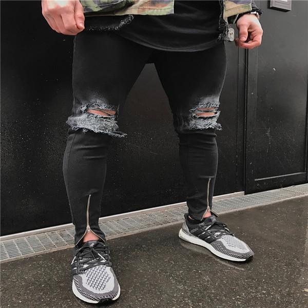 Il commercio all'ingrosso libero di trasporto del progettista degli uomini ha distrutto i jeans strappati mens hip-hop biker lavano i pantaloni blu del denim il motociclo casuale esile