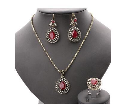 Conjunto de joyas de rubíes de moda en todas partes Sky Star cristal austriaco Bronce antiguo de tres piezas accesorios de la boda Joyería de Turquía