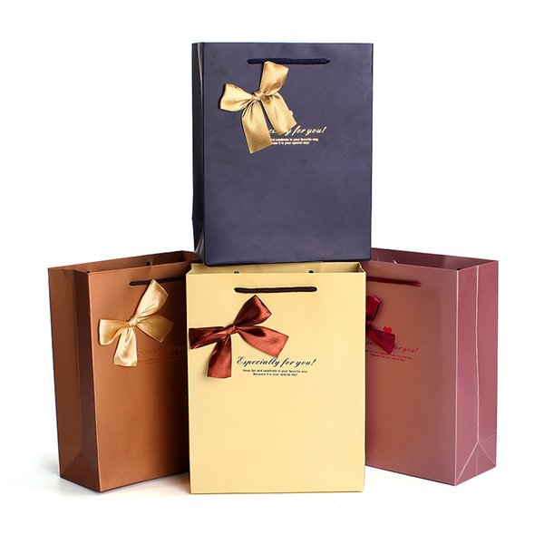 best selling Nice gift bag 4 colors stock art paper shopping bag with handles and butterfly decoration ELB165