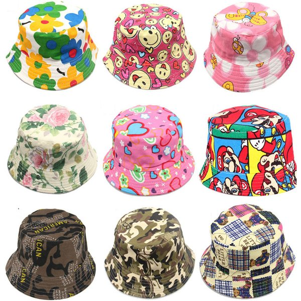 top popular 2015 hot Bucket sun hat for kids Children floral Hats 30 colors baby girls fashion Grass Fisherman Straw hat topee free ship SVS0186# 2019