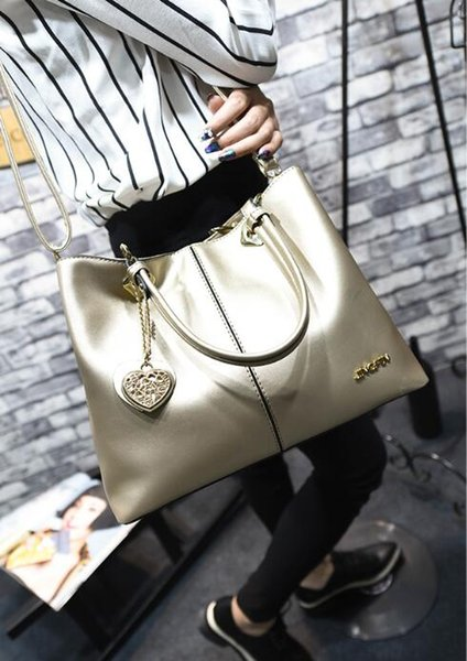 The new Europe fashion women handbag leather laides bag shimmer tote bag shoulder bag with low price ,free shipping