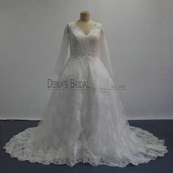 2017 Ball Gown Wedding Dresses with V Neck Illusion Long Sleeves V Back Covered Buttons Lace Court Train Pearls Appliques Bridal Gowns