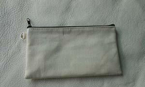 cream-coloured/black zipper