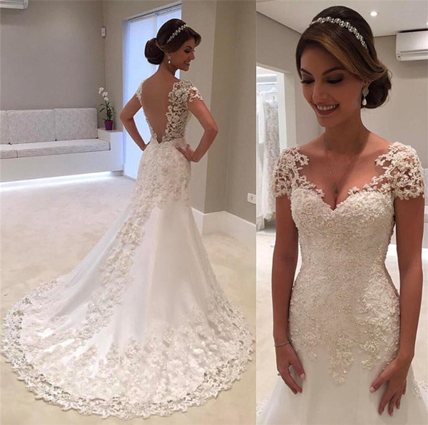 top popular V-neck Appliqued Lace Illusion Back Bridal Dress Formal Gown For Brides Cap Sleeve Mermaid Wedding Dresses Gowns Count Train 2019
