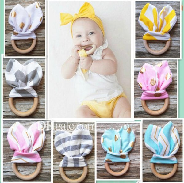 best selling 28 Colors baby Wooden Teether Ring Baby bunny Wooden Teething training with Crinkle Material Inside Sensory Toy Natural teether bell BTR01